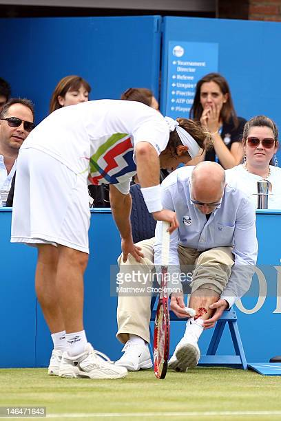 David Nalbandian of Argentina looks at the line judge's bloody leg after injuring him during his mens singles final round match against Marin Cilic...