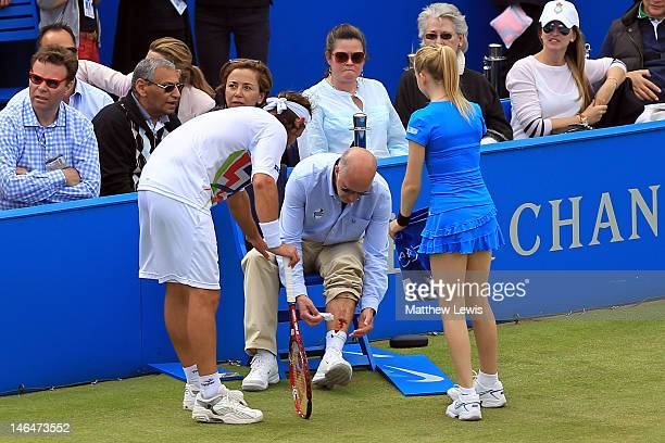 David Nalbandian of Argentina looks at the Line Judges bloody leg after injuring him during his mens singles final round match against Marin Cilic of...