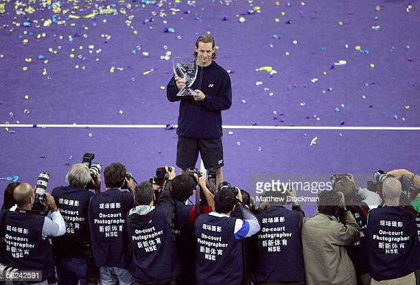 David Nalbandian of Argentina poses for photographers after defeating Roger Federer of Switzerland during the final of the Tennis Masters Cup at Qi...