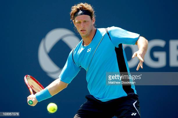 David Nalbandian of Argentina returns a shot to Robin Soderling of Sweden during the Rogers Cup at the Rexall Centre on August 12 2010 in Toronto...