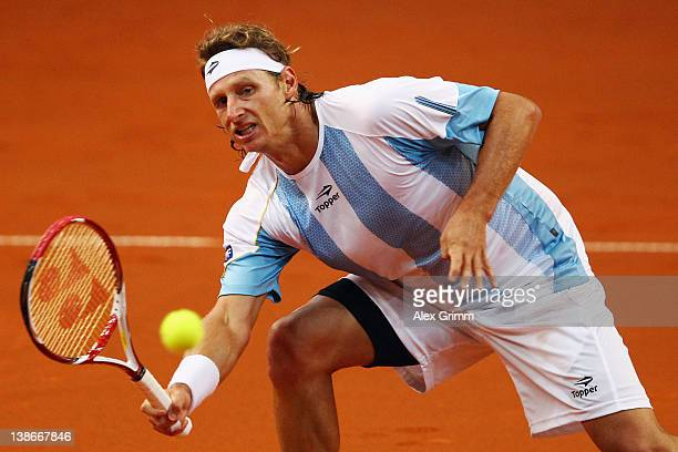 David Nalbandian of Argentina returns the ball to Florian Mayer of Germany during the Davis Cup World Group first round match between Germany and...