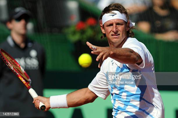 David Nalbandian of Argentina returns the ball to Marin Cilic during the series between Argentina and Croatia for the quarterfinals of the Davis Cup...