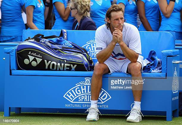 David Nalbandian of Argentina shows his dejection after learning of his disqualification for unsportsmanlike conduct during his mens singles final...