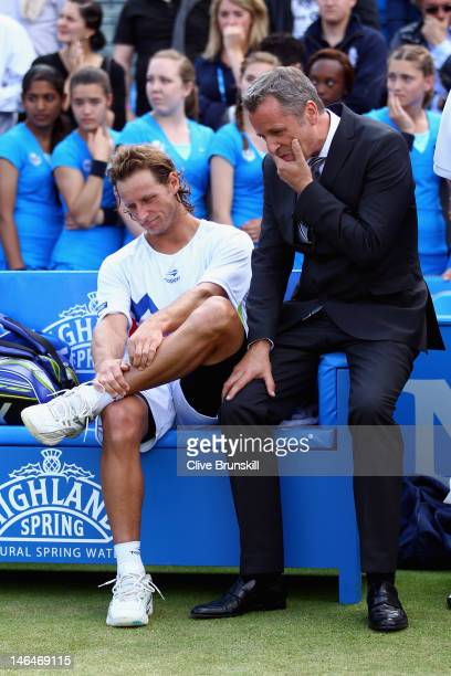 David Nalbandian of Argentina shows his dejection alongside Tournament Director Chris Kermode after learning of his disqualification for...