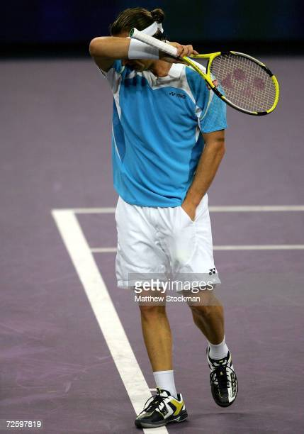 David Nalbandian of Argentina walks back to the baseline between points against James Blake of the United States during the semifinals of the Tennis...