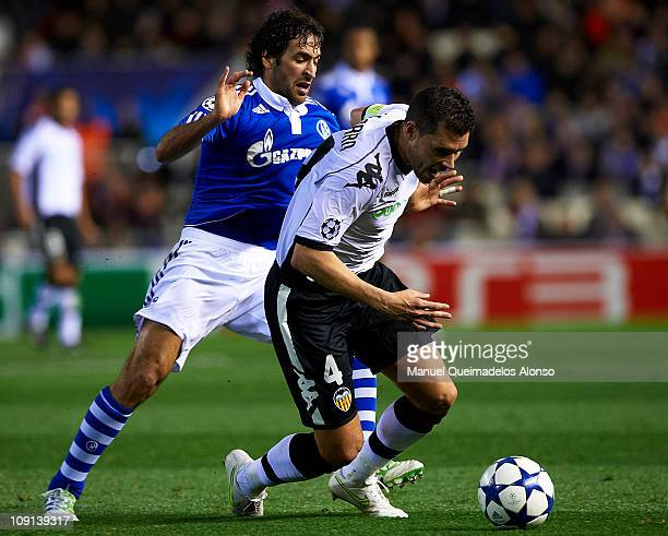 David Navarro of Valencia duels for the ball with Raul Gonzalez of Schalke during the UEFA Champions League Round of 16 1st leg match between...