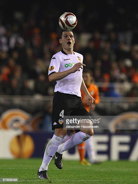 David Navarro of Valencia runs with the ball during the UEFA Europa League round of 16 first leg match between Valencia and SV Werder Bremen at...