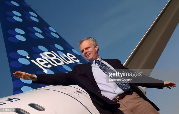 David Neeleman Chief Executive Officer of Jet Blue Airways gestures as he stands next to Jet Blue's new 38th aircraft featuring the new PucciEsque...