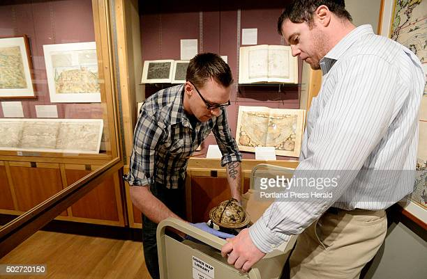 David Neikirk digital imaging coordinator left and Ian Foller director at Osher Map Library and Smith Center take a 1607 William Blaeu celestial...