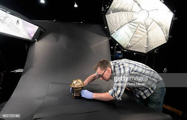 David Neikirk digital imaging coordinator sets up a 1607 William Blaeu celestial globe to be photographed at The Osher Map Library at the University...