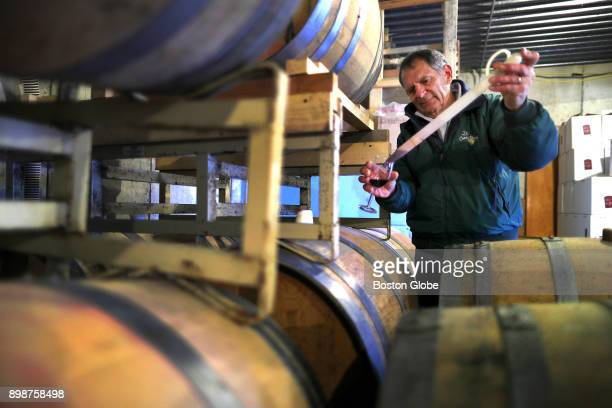 David Neilson draws a sample from an oak barrel at his winery in Dartmouth MA on Nov 15 2017 Shortly after his 50th birthday Neilson got serious...