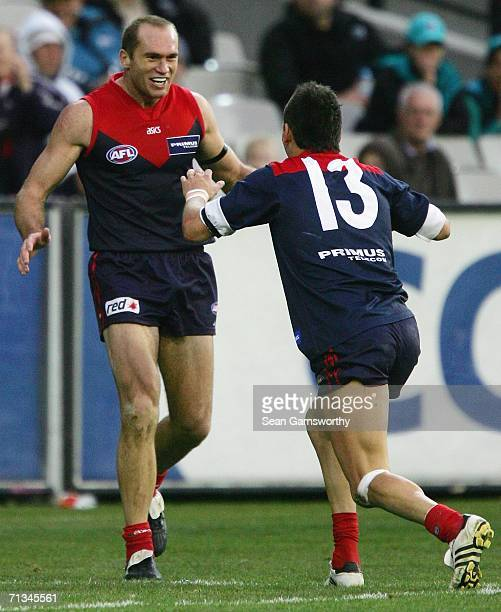 David Neitz and Adem Yze for Melbourne celebrate a goal during the round thirteen AFL match between Melbourne and Port Adelaide at the Melbourne...