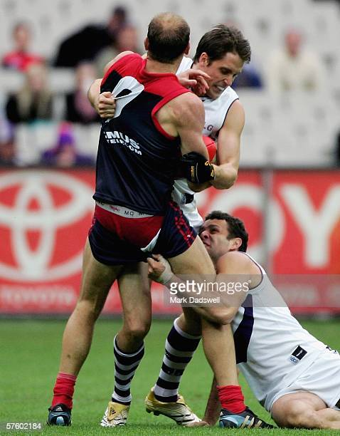 David Neitz of the Demons loses his shorts in a tackle by Luke McPharlin and Antoni Grover of the Dockers during the round seven AFL match between...