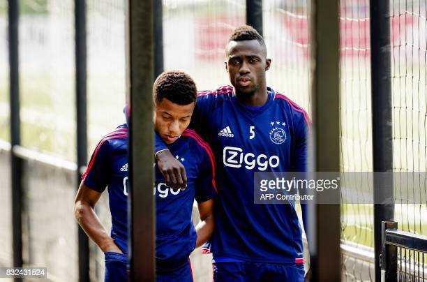 David Neres and Davinson Sanchez of Ajax walk during the training in Amsterdam on August 16 in preparation of the first playoff match of the Europa...