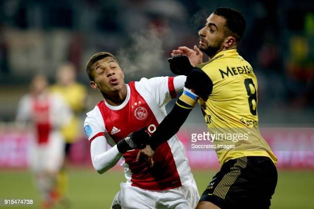David Neres of Ajax Adil Auassar of Roda JC during the Dutch Eredivisie match between Roda JC v Ajax at the Parkstad Limburg Stadium on February 7...