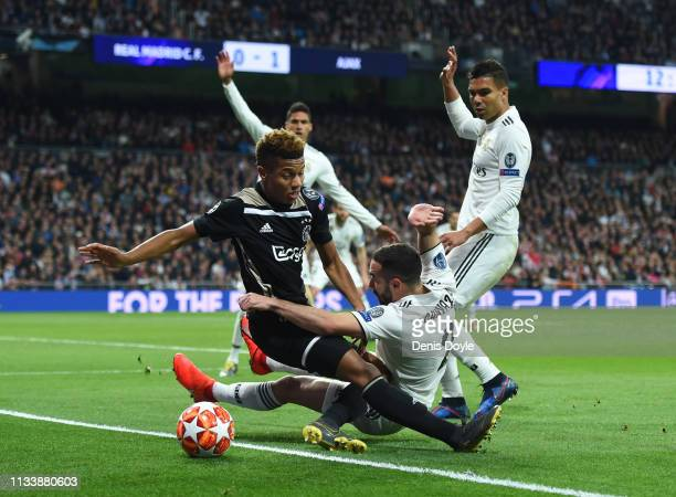 David Neres of Ajax and Daniel Carvajal of Real Madrid battle for the ball during the UEFA Champions League Round of 16 Second Leg match between Real...
