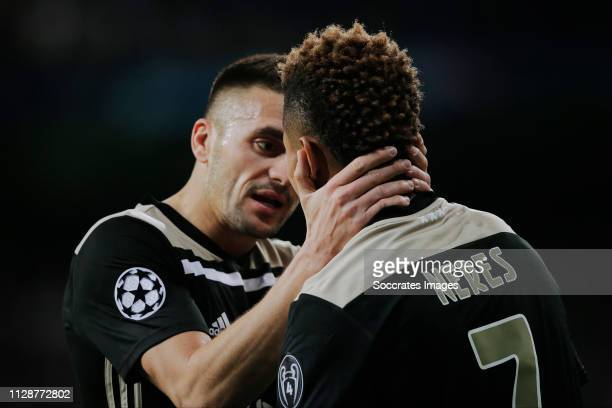 David Neres of Ajax celebrates 02 with Dusan Tadic of Ajax during the UEFA Champions League match between Real Madrid v Ajax at the Santiago Bernabeu...