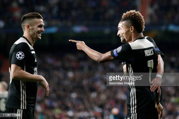 David Neres of Ajax celebrates 02 with Dusan Tadic of Ajax Hakim Ziyech of Ajax during the UEFA Champions League match between Real Madrid v Ajax at...