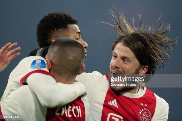 David Neres of Ajax celebrates 10 with Hakim Ziyech of Ajax Lasse Schone of Ajax during the Dutch Eredivisie match between Ajax v PSV at the Johan...