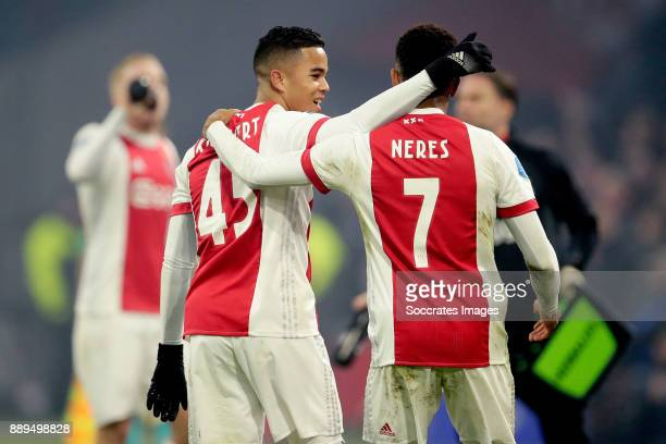 David Neres of Ajax celebrates 10 with Justin Kluivert of Ajax during the Dutch Eredivisie match between Ajax v PSV at the Johan Cruijff Arena on...
