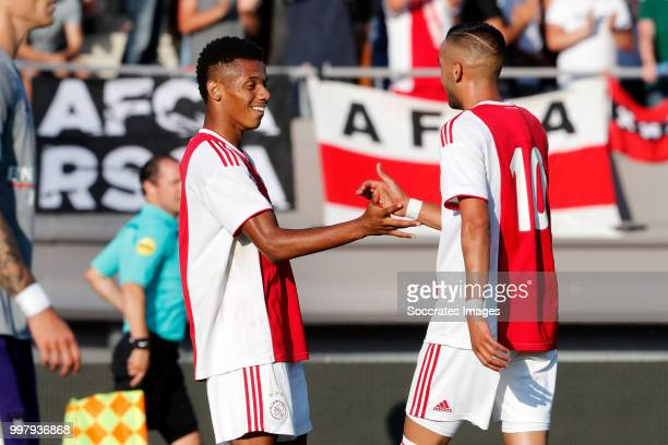 David Neres of Ajax celebrates 11 with Hakim Ziyech of Ajax during the Club Friendly match between Ajax v Anderlecht at the Olympisch Stadion on July...