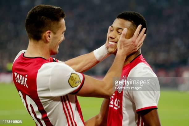 David Neres of Ajax celebrates 3-0 with Dusan Tadic of Ajax during the Dutch Eredivisie match between Ajax v Feyenoord at the Johan Cruijff Arena on...