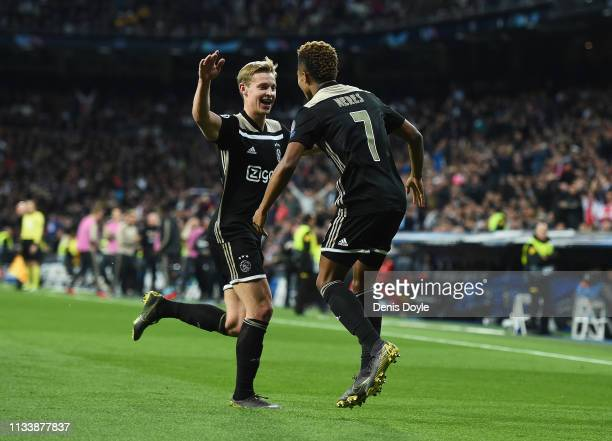 David Neres of Ajax celebrates as he scores his team's second goal with Frenkie de Jong during the UEFA Champions League Round of 16 Second Leg match...