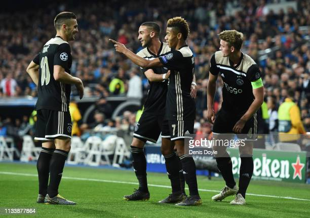 David Neres of Ajax celebrates as he scores his team's second goal with team mates during the UEFA Champions League Round of 16 Second Leg match...
