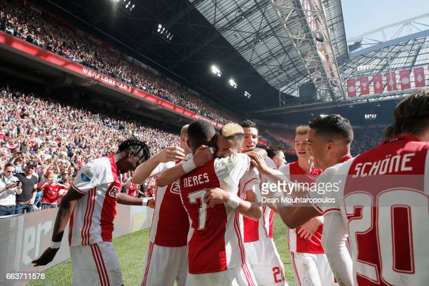 David Neres of Ajax celebrates scoring his teams second goal of the game with team mates during the Dutch Eredivisie match between Ajax Amsterdam and...