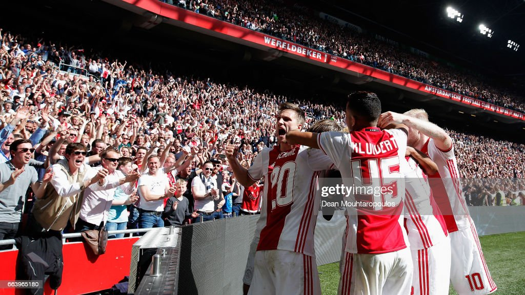 David Neres of Ajax celebrates scoring his teams second goal of the game with team mates during the Dutch Eredivisie match between Ajax Amsterdam and Feyenoord at Amsterdam ArenA on April 2, 2017 in Amsterdam, Netherlands.