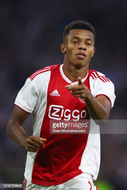 David Neres of Ajax celebrates scoring his teams third goal of the game during the UEFA Champions League third round qualifying match between Ajax...