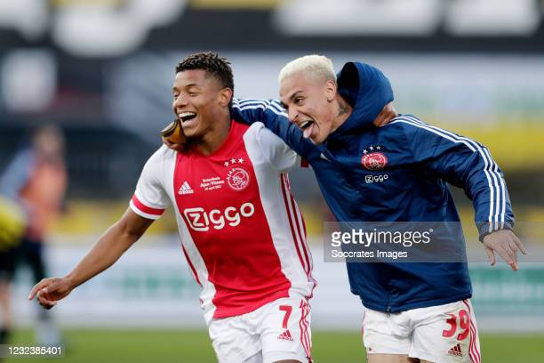 David Neres of Ajax Celebrates with Antony of Ajax during the Dutch KNVB Beker match between Ajax v Vitesse at the Stadium Feijenoord on April 18,...