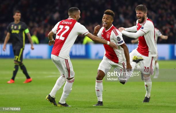 David Neres of Ajax celebrates with teammates after scoring his team's first goal during the UEFA Champions League Quarter Final first leg match...