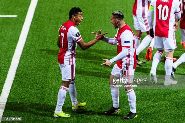 David Neres of Ajax celebrating his goal with his teammate Antony dos Santos of Ajax during the UEFA Europa League Round of 16 Second Leg match...