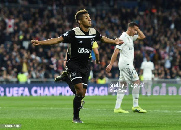 David Neres of Ajax celerbates as he scores his team's second goal during the UEFA Champions League Round of 16 Second Leg match between Real Madrid...