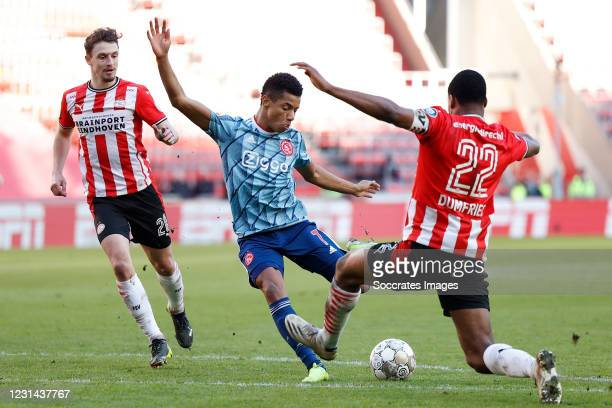 David Neres of Ajax, Denzel Dumfries of PSV during the Dutch Eredivisie match between PSV v Ajax at the Philips Stadium on February 28, 2021 in...