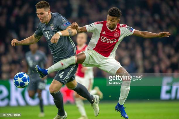 David Neres of Ajax fights for the ball Niklas Sule of Bayern during the UEFA Champions League Group E match between AFC Ajax Amsterdam and FC Bayern...