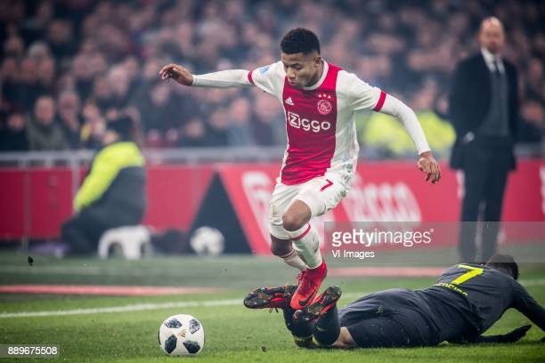 David Neres of Ajax Gaston Pereiro of PSV during the Dutch Eredivisie match between Ajax Amsterdam and PSV Eindhoven at the Amsterdam Arena on...