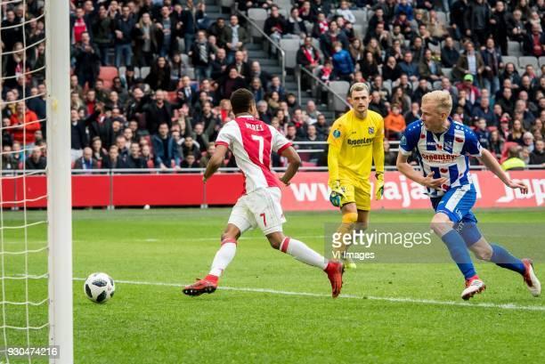 David Neres of Ajax goalkeeper Martin Hansen of sc Heerenveen Lucas Woudenberg of sc Heerenveen 41 during the Dutch Eredivisie match between Ajax...