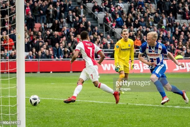 David Neres of Ajax goalkeeper Warner Hahn of sc Heerenveen Lucas Woudenberg of sc Heerenveen 41 during the Dutch Eredivisie match between Ajax...