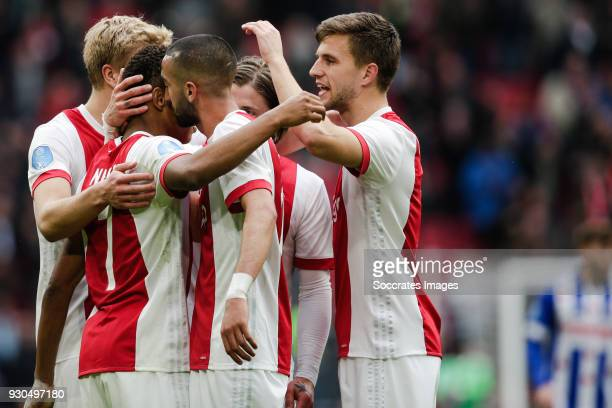 David Neres of Ajax Hakim Ziyech of Ajax Joel Veltman of Ajax celebrate the 41 during the Dutch Eredivisie match between Ajax v SC Heerenveen at the...