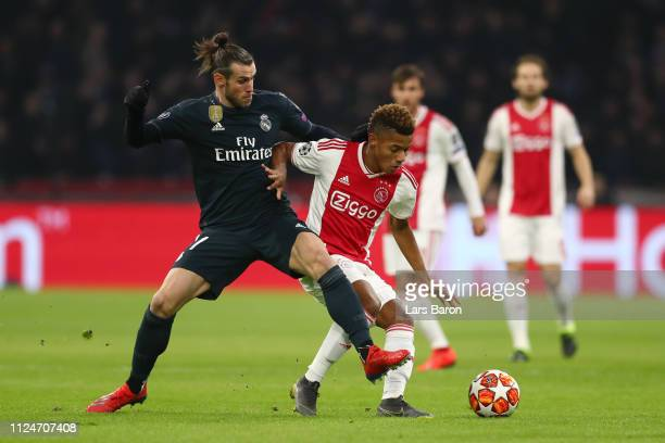 David Neres of Ajax is challenged by Gareth Bale of Real Madrid during the UEFA Champions League Round of 16 First Leg match between Ajax and Real...