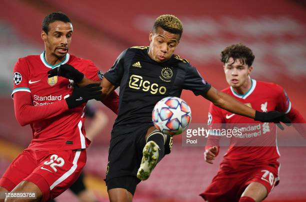 David Neres of Ajax is challenged by Joel Matip of Liverpool during the UEFA Champions League Group D stage match between Liverpool FC and Ajax...