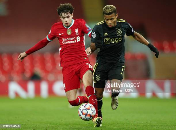 David Neres of Ajax is challenged by Neco Williams of Liverpool during the UEFA Champions League Group D stage match between Liverpool FC and Ajax...