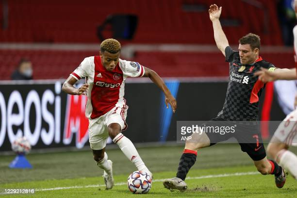 AMSTERDAM David Neres of Ajax James Milner or Liverpool FC during the UEFA Champions League match in group D between Ajax Amsterdam and Liverpool FC...