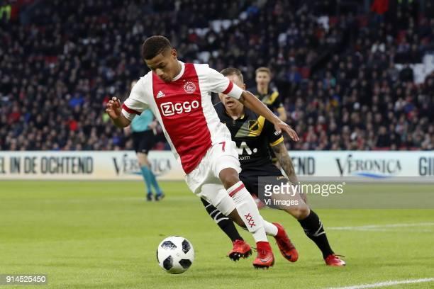 David Neres of Ajax Jose Angelino of NAC Breda during the Dutch Eredivisie match between Ajax Amsterdam and NAC Breda at the Amsterdam Arena on...