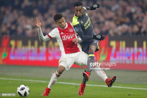 David Neres of Ajax Joshua Brenet of PSV during the Dutch Eredivisie match between Ajax v PSV at the Johan Cruijff Arena on December 10 2017 in...
