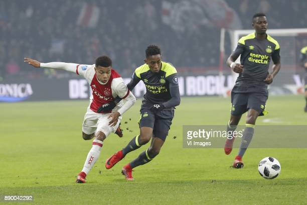 David Neres of Ajax Joshua Brenet of PSV Nicolas IsimatMirin of PSV during the Dutch Eredivisie match between Ajax Amsterdam and PSV Eindhoven at the...