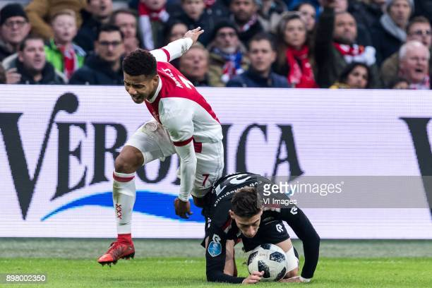 David Neres of Ajax Konstantinos Tsimikas of Willem II during the Dutch Eredivisie match between Ajax Amsterdam and Willem II Tilburg at the...