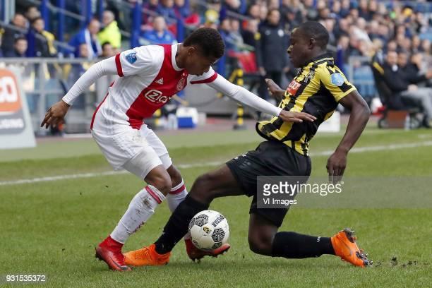David Neres of Ajax Lassana Faye of Vitesse during the Dutch Eredivisie match between Vitesse Arnhem and Ajax Amsterdam at Gelredome on March 04 2018...